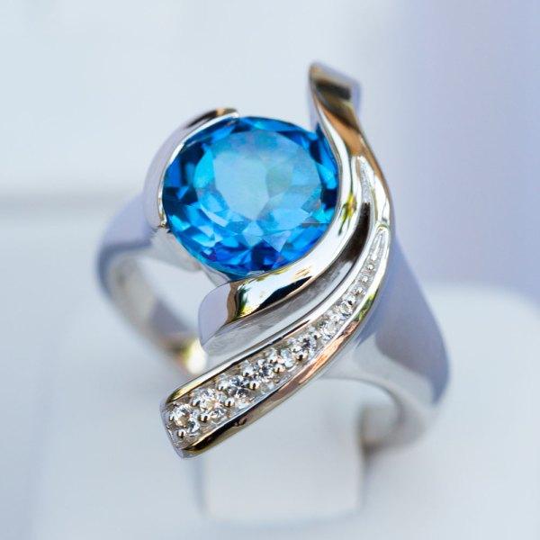 Kashmir Blue Topaz & White Sapphire Wave Ring angle view.
