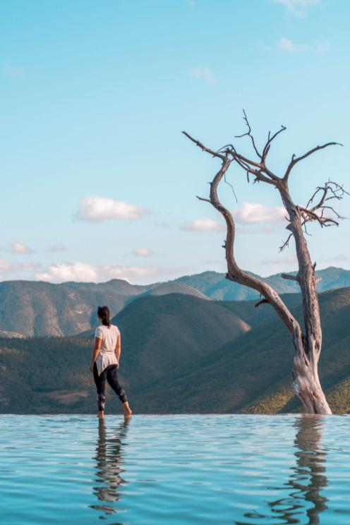 At the edge of natural infinity pool at Hierve al Agua (what to do in Oaxaca)