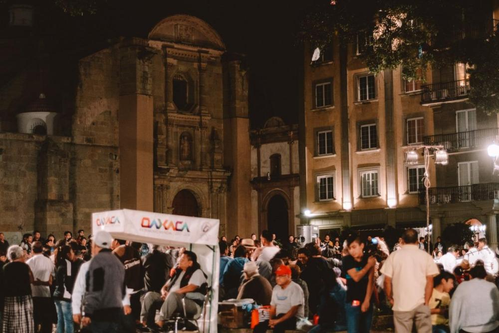Crowds of people at Zocalo at night (what to do in Oaxaca suggestion)