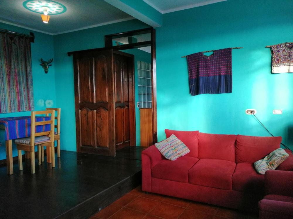 Guatemala travel budget - colorful living room in our Airbnb was definitely worth the money