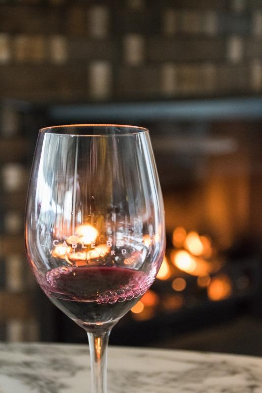 A glass of pinot noir in winery on Waiheke Island - one of the ideas how to spend 3 days in Auckland