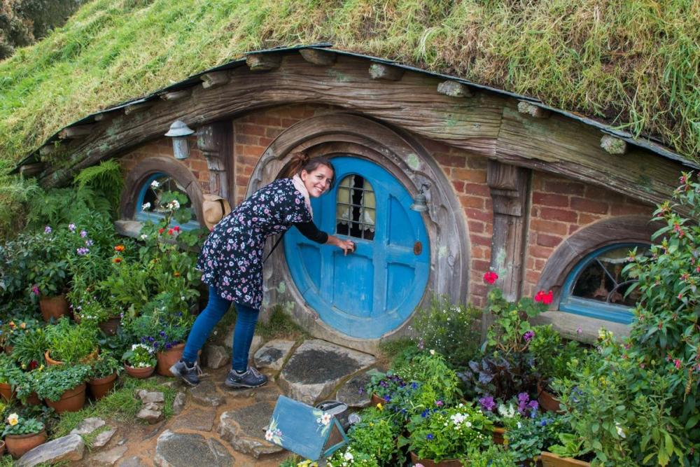 Me in front of the blue doors of a Hobbit hole