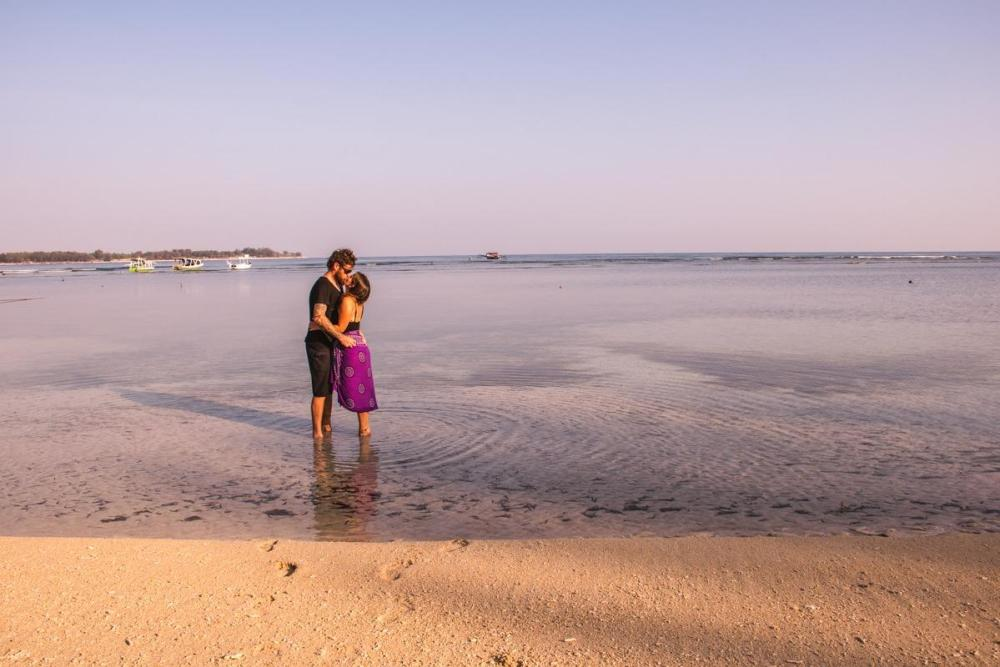 A golden hour in Gili Air - us in the shallow waters (our yearlong honeymoon)