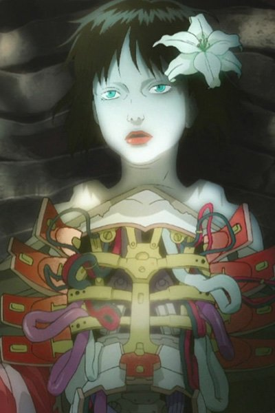 A robotic geisha with an open chest cavity.