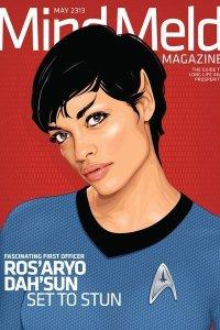 Rosario Dawson as a Vulcan wearing a blue Starfleet uniform.
