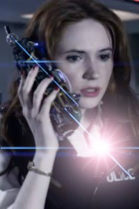 Poor Amy Pond being attacked by lens flares on the shiny bridge of a doomed starliner.