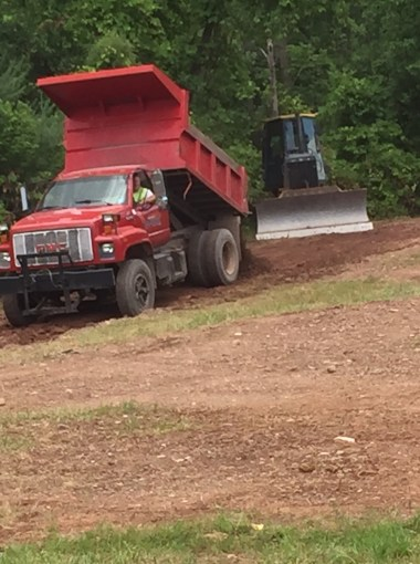 Ryan and Bucky creating new road for Spartan Race parking.