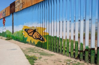 Art decorating the border fence