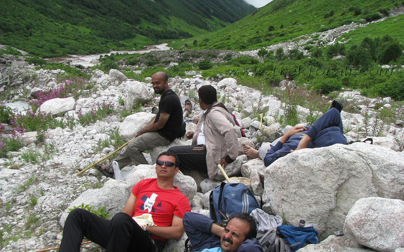 Group members taking rest after lunch deep inside Valley of Flowers.