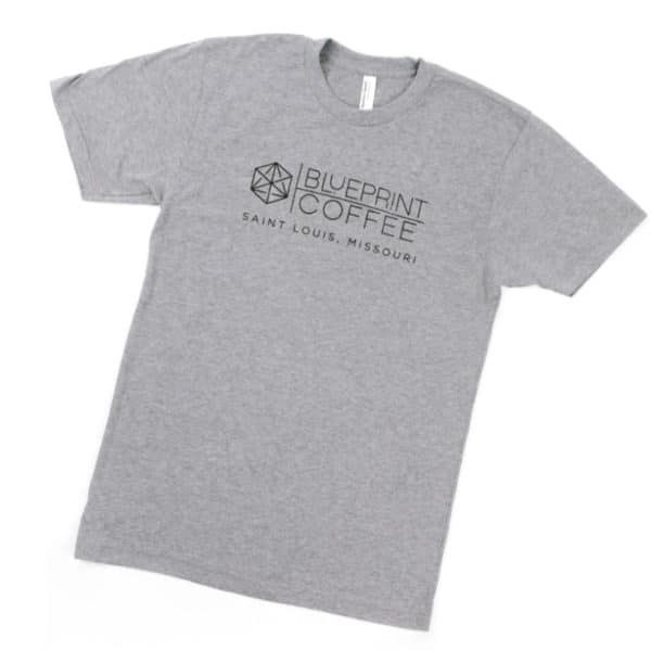 A grey American Apparel t-shirt bearing the Blueprint Coffee cube and text logo across the front.
