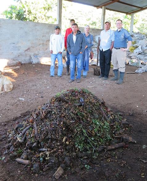 Purposefully built compost and the farm staff at La Esperanza in Guatemala. January 2017.