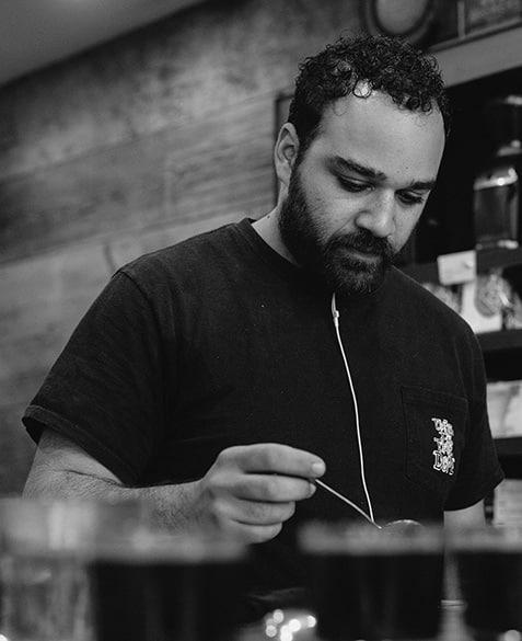 Mazi Razani cupping (tasting) coffee at Blueprint.