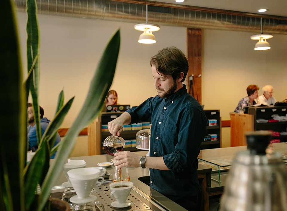 Kevin Reddy finishes a brew on the Blueprint Coffee brew bar.