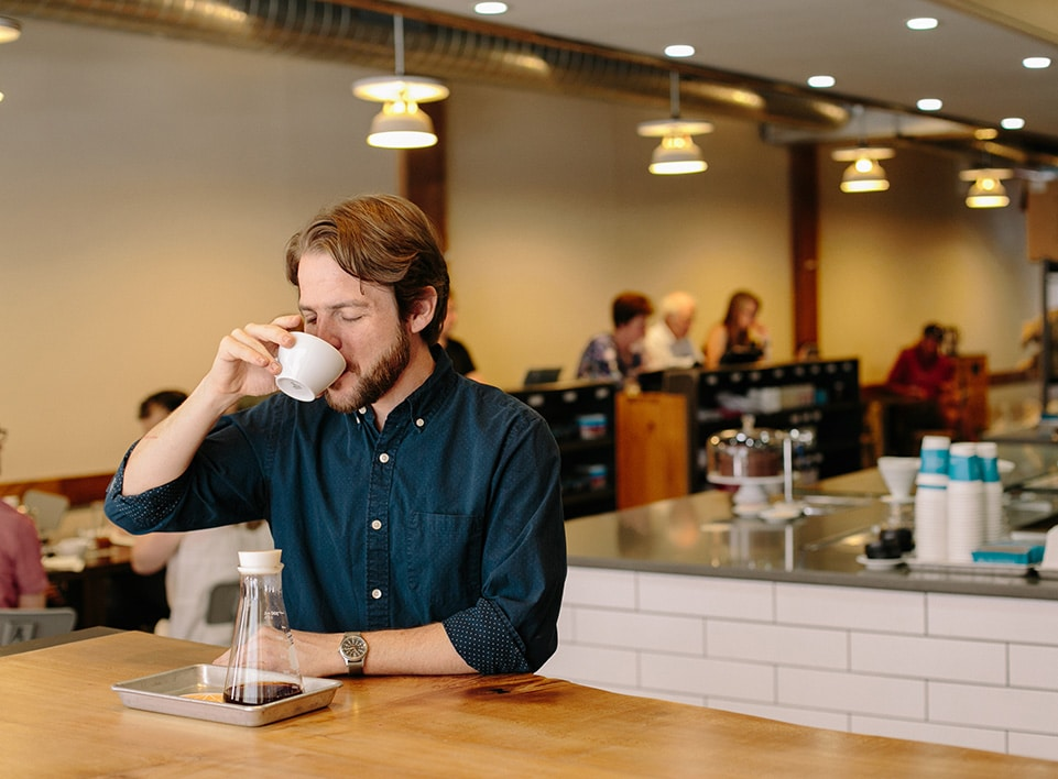 Kevin Reddy takes a moment to enjoy a cup of coffee at Blueprint.