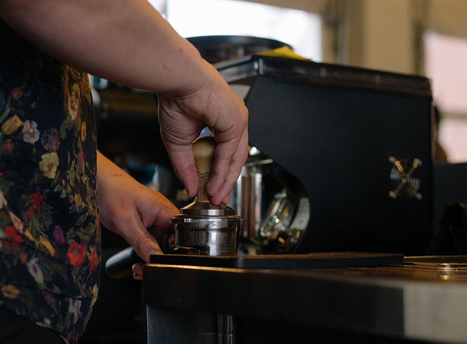 Alex Werth prepares a shot of espresso at Blueprint Coffee Watson.