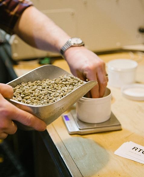 Andrew Timko prepares coffee for sample roasting.