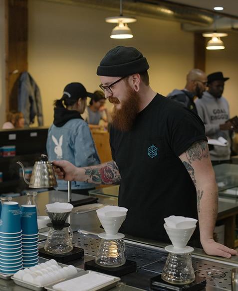 ryan stakes brews a coffee at blueprint coffee delmar