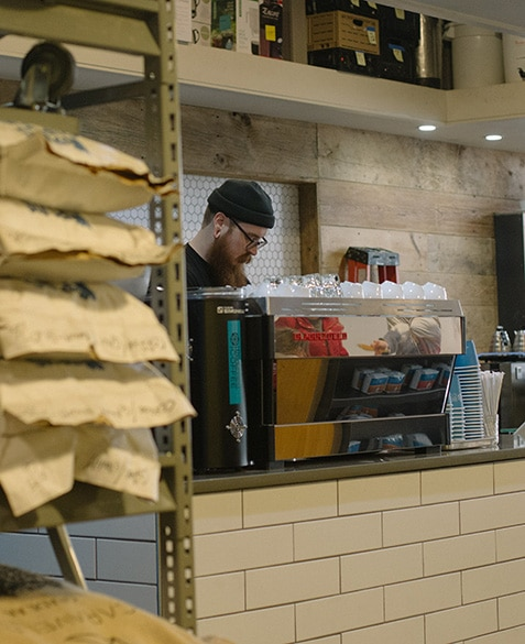 ryan stakes prepares espresso drinks at blueprint coffee delmar