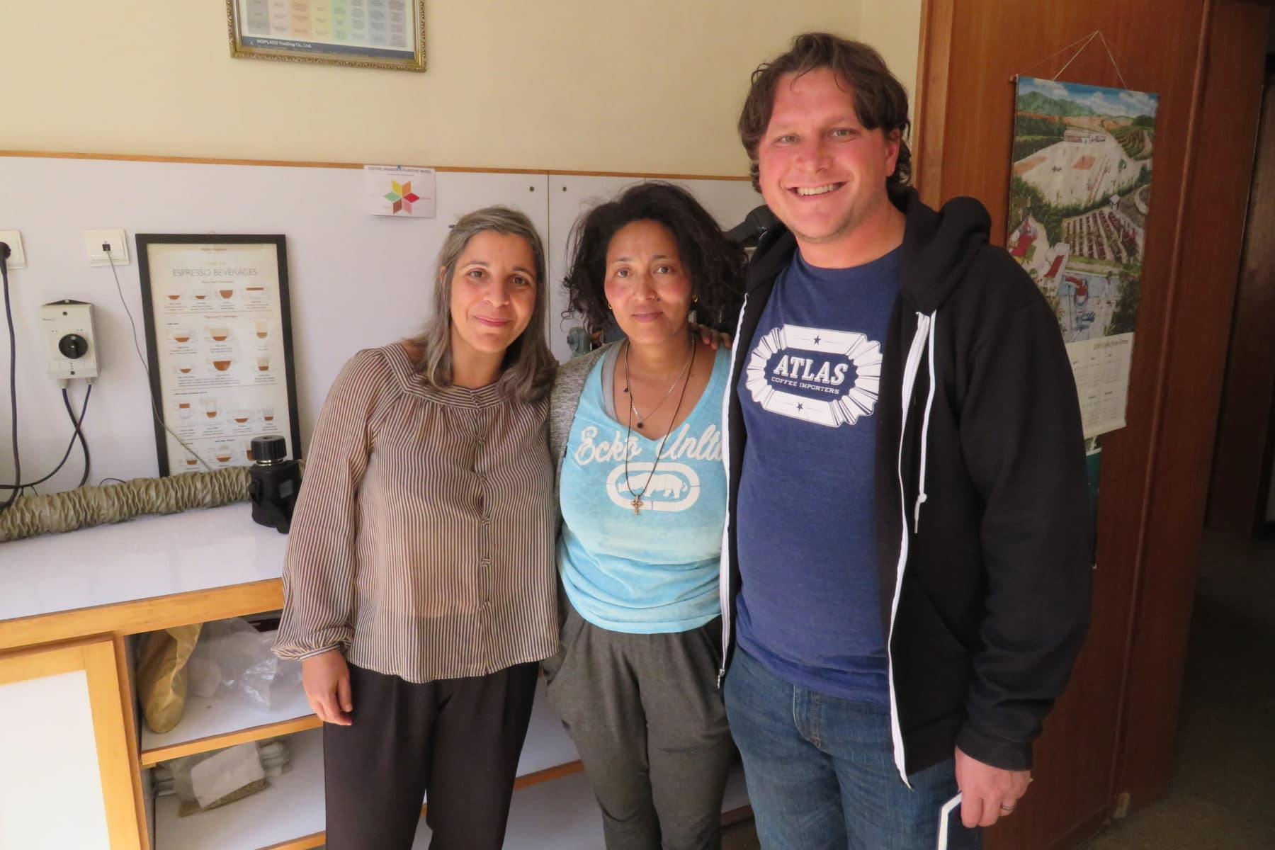Blueprint member Mike Marquard poses with Heleanna Georgalis and Hana Kassahun Biligin of Moplaco, one of Blueprint's coffee sourcing partners in Ethiopia.