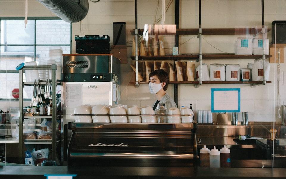 MG Batts working behind the coffee bar at Blueprint Coffee Watson