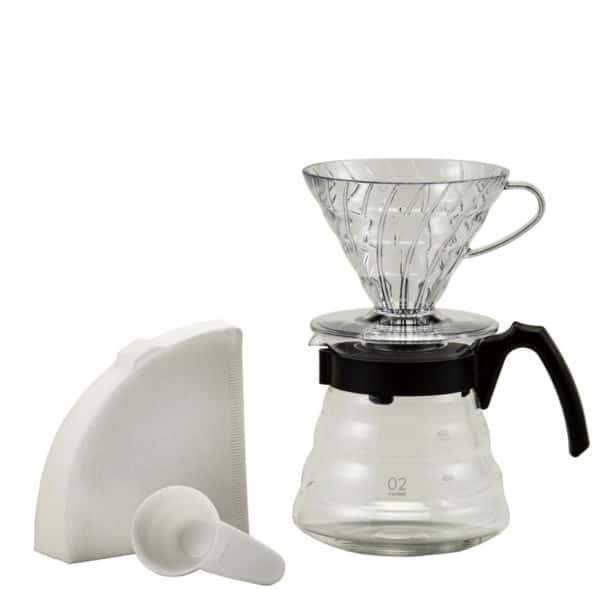 The v60 brewing set includes a dripper, decanter, starter pack of filters, and a plastic scoop.