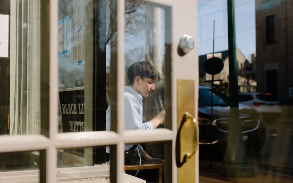 Mac sits outside Blueprint Coffee Delmar