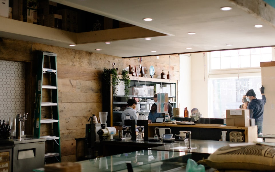Mac assists customers at Blueprint Coffee Delmar
