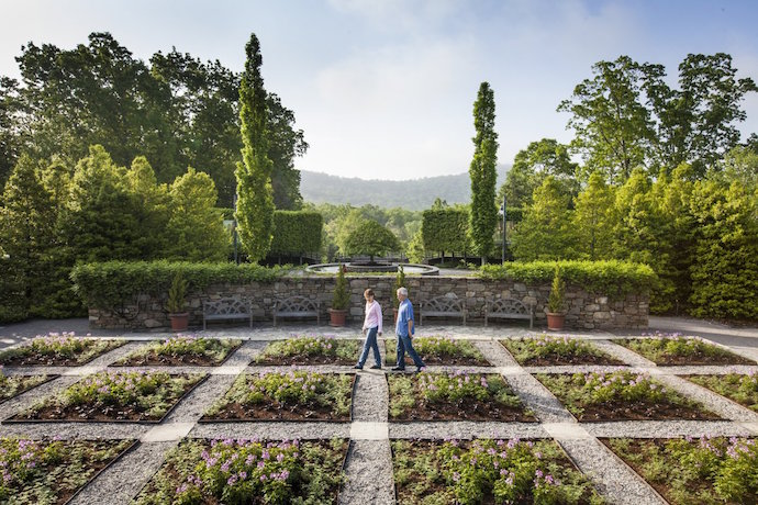 Couple walking in Botanical Gardens at NC Arboretum in Asheville