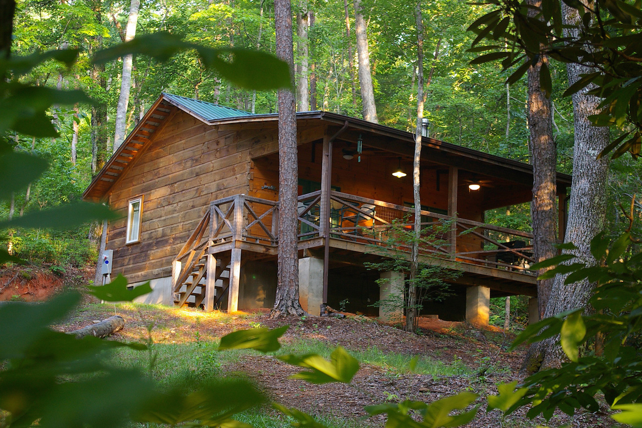 Exterior view of Outrigger Log Cabin at Cottages at Spirng House Farm near Marion, NC