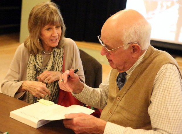 Wendell Berry autographing a book for Jeri Rogers at the Eco-Center earlier in the day.
