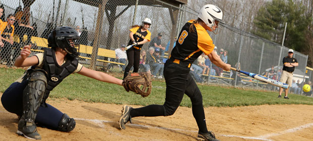 Amanda Whitlow delivers key hit in bottom of the eighth.