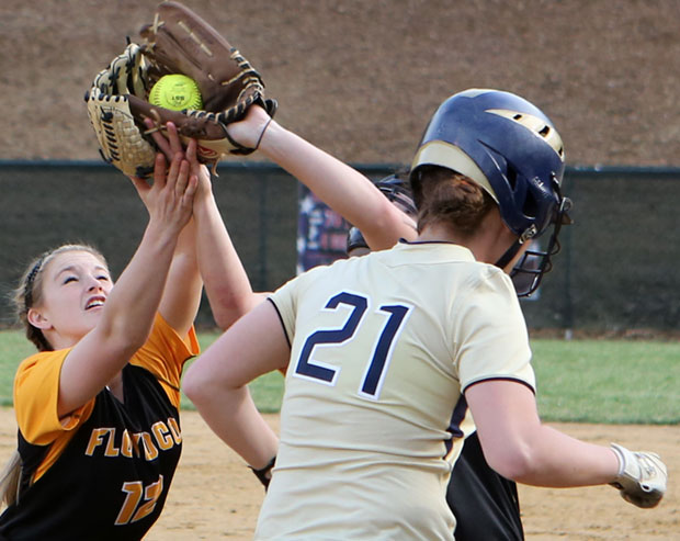 Ashley Gallimore and Holly Britt double up for an out.