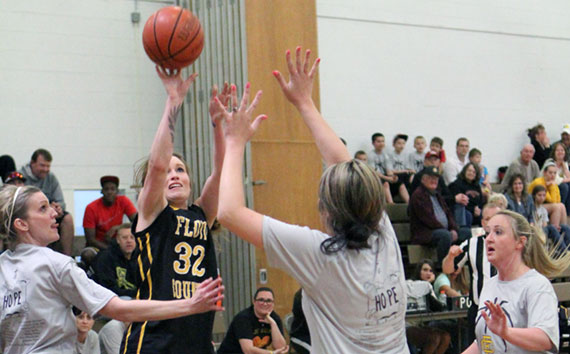 Brittney Avencini, a member of the 2008 state championship team, scores a three-pointer.