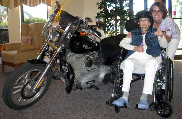 Celebrating at her assisted living facility in 2010 with her son's Harley-Davidson