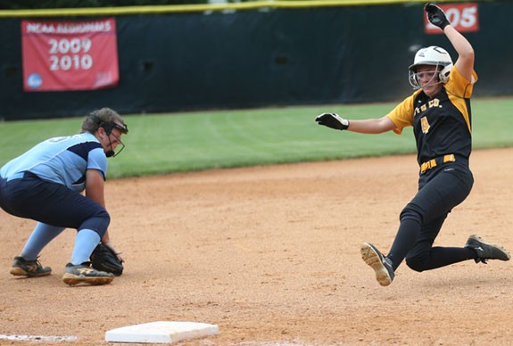 Holly Britt slides safely into third but is unable to score.