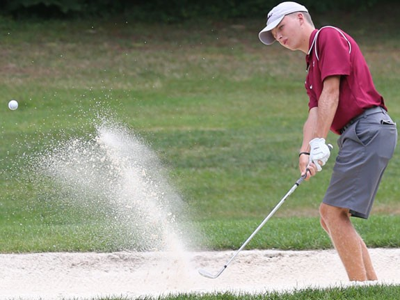 George Wythe blasts out of a sand trap.