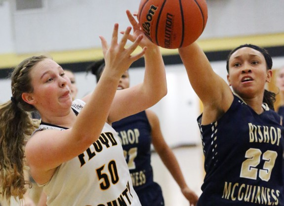 Maggie Eanes fights for the ball with Bishop McGuiness (Photos by Doug Thompson)