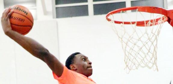 Slamming the ball home in the slam-dunk contest (Photos by Doug Thompson)