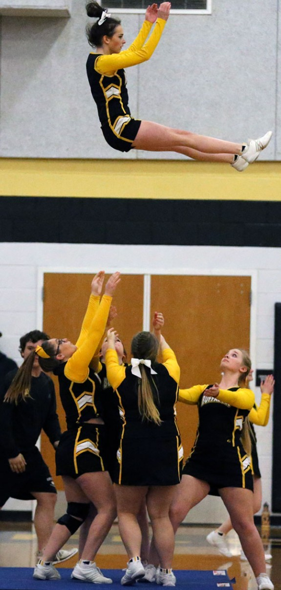 The Buffaloes basketballers and the cheerleaders were flying high. (Photos by Doug Thompson)