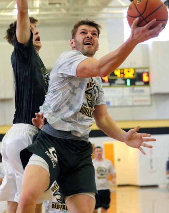 More alumni action is recent male graduates in basketball.