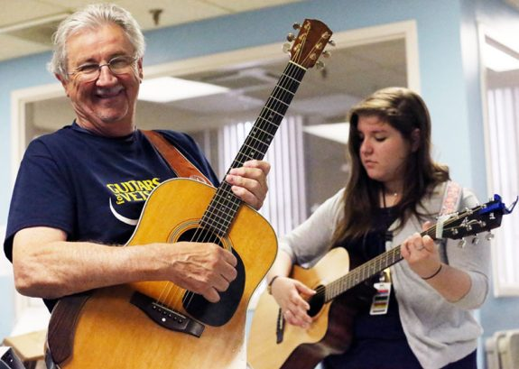 Bernie Coveney and one of the VA therapists at the Salem Medical Center Monday.