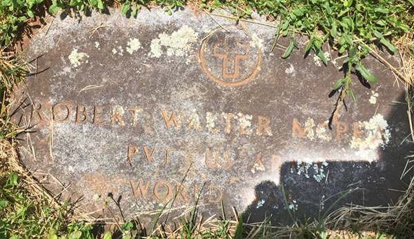 The faded and worn plaque honoring the World War I military service of Pvt. Robert W. McPeak of the U.S. Army.