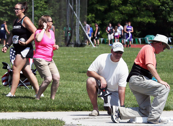 Officials confirm and the celebrations begin as Akers walks away with a new state shot put record -- for the second time in the same day.
