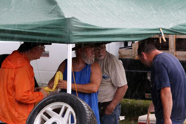 When the rain comes, a scramble for cover in vendor tents.