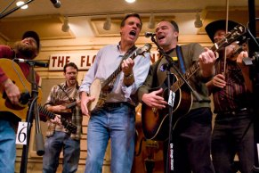 Mark Warner and Tim Kaine on stage at The Friday Night Jamboree with The Jugbusters.