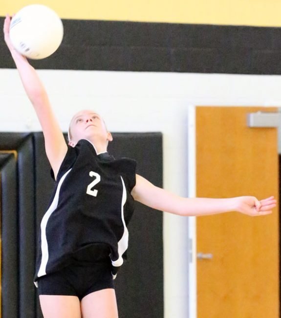 A strong serve in the Middle School match against the Cavaliers led to a strong win.