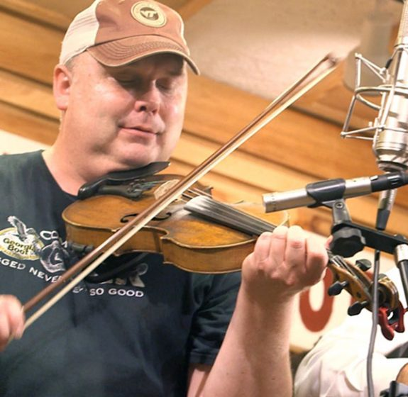 Eddie Bond and his fiddle in a performance by The New Ballard's Branch Bogtrotters.