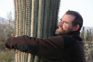 Craig Childs hugging cactus