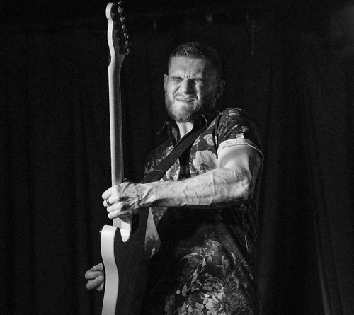 Dirty Laundry on Show as Ben Poole Plays his Guitar