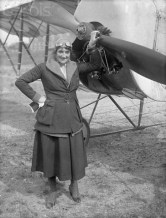 July 1919 --- Original caption: 7/1919- Portrait of famous French aviatrix Baroness de la Roche, who was killed Friday when the plane she was flying at Crotoy, France collapsed. This photo of the Baroness was made two weeks ago after she broke the world's record for altitude reached by a woman, formerly held by Ruth Law. The Baroness is shown standing in front of the machine in which she was killed. She was the world's first woman flier, having won her pilot's license in 1910. --- Image by © Bettmann/CORBIS
